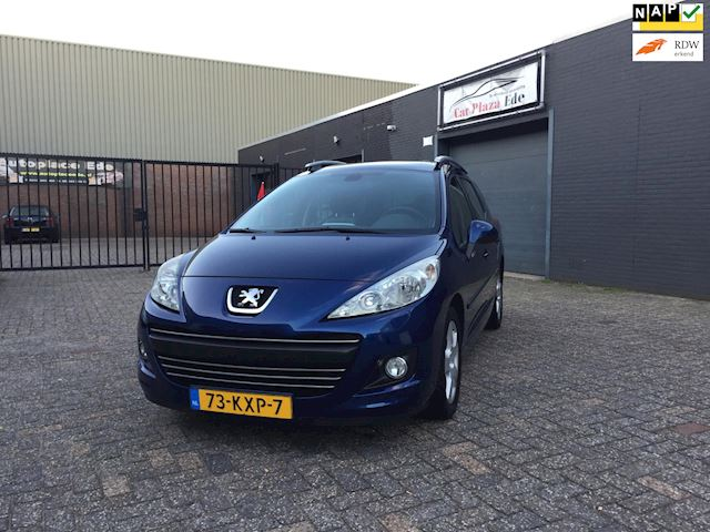 Peugeot 207 SW 1.6 VTi Blue Lease Executive Clima Cruise Navi Pano Trekhaak APK NAP.