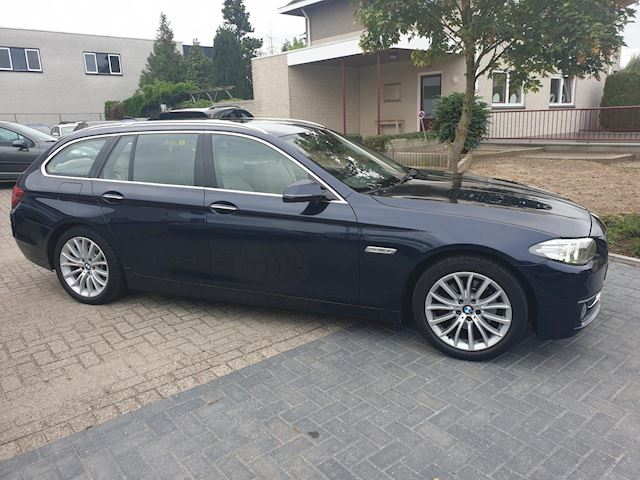 BMW 5-serie Touring 520i Luxury Edition Automaat SportLeder Navigatie