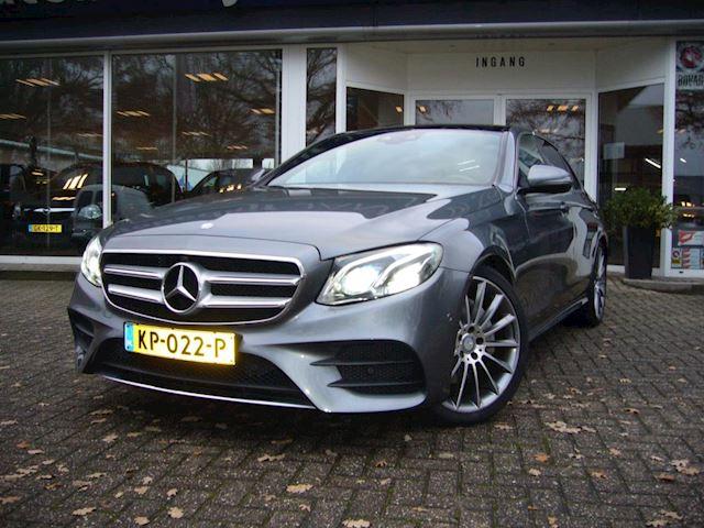 Mercedes-Benz E-klasse 200 Ambition Automaat + Navigatie + PDC + Panoramadak +AMG-sportpakket interieur en exterieur