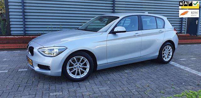 BMW 1-serie 2.0 116D 5DR 85KW 2012 Grijs PDC*NAVI*XENON*APK