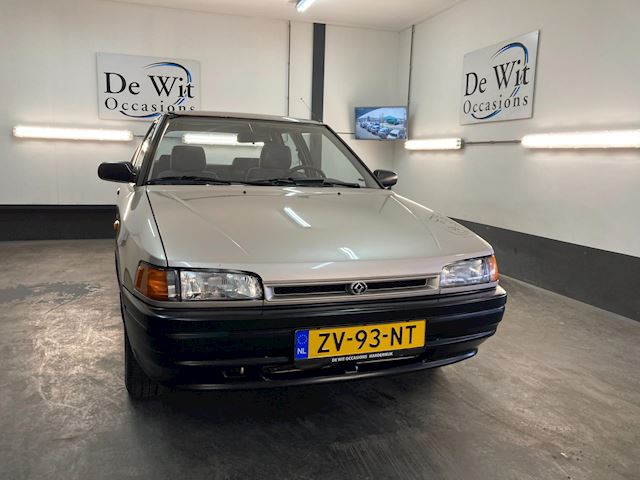 Mazda 323 1.6i LX uitv. van 2e EIG.!! AUTOMAAT met ORG. 104000km. NWE APK/GARANTIE.